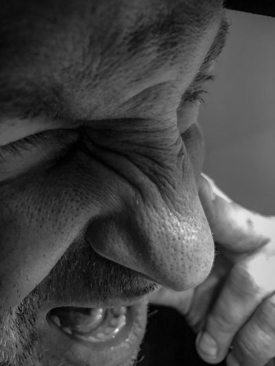 Close-up of man making face