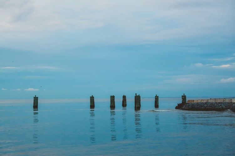 Pier Mobile Bay Alabama Clouds Fort Morgan Mobile Bay Water Sky Sea Waterfront Scenics - Nature Cloud - Sky Post Beauty In Nature Wooden Post Day Nature No People Tranquility Horizon Over Water Horizon Blue Tranquil Scene Outdoors Idyllic