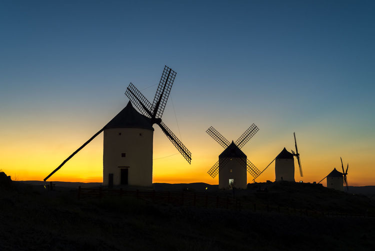 Quixote Windmill Alternative Energy Architecture Building Exterior Built Structure Environment Environmental Conservation Field Fuel And Power Generation Land Landscape Nature No People Outdoors Renewable Energy Silhouette Sky Sunset Technology Traditional Windmill Turbine Wind Power Wind Turbine