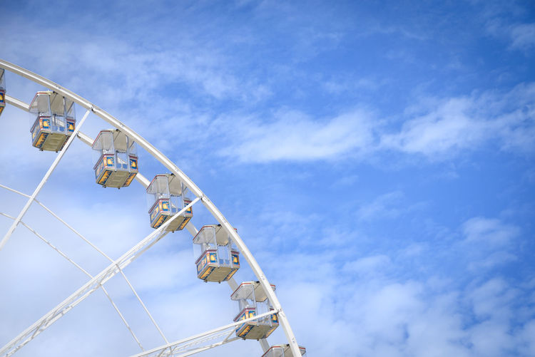 Part of a ferris wheel against a blue summer sky Clouds Copy Space Fair Ferris Wheel First Eyeem Photo Fun Funfair High High In The Sky Leisure Activity Negative Space Part Of Sky Summer Summertime Up