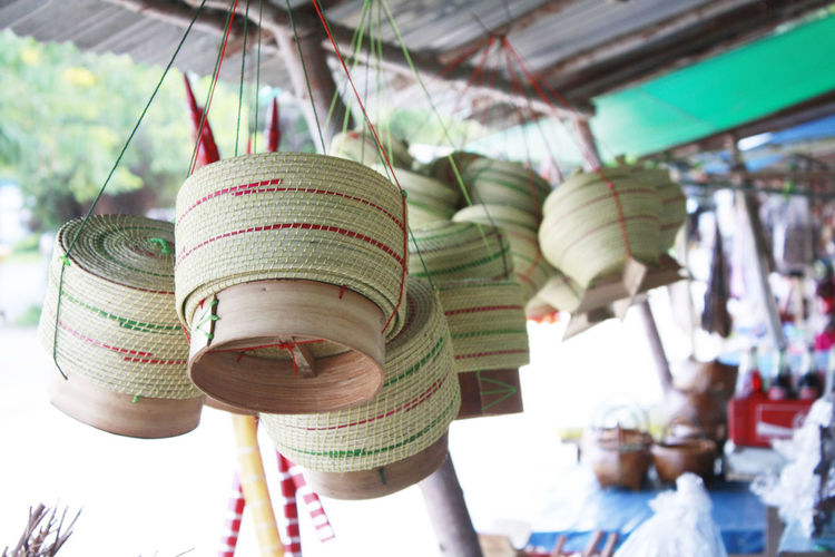 Low angle view of wicker baskets in market for sale