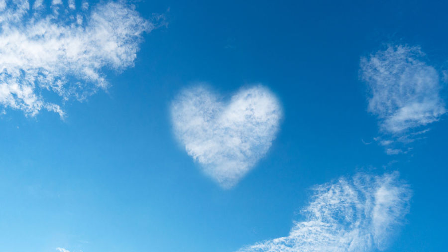 Low angle view of heart shape against blue sky