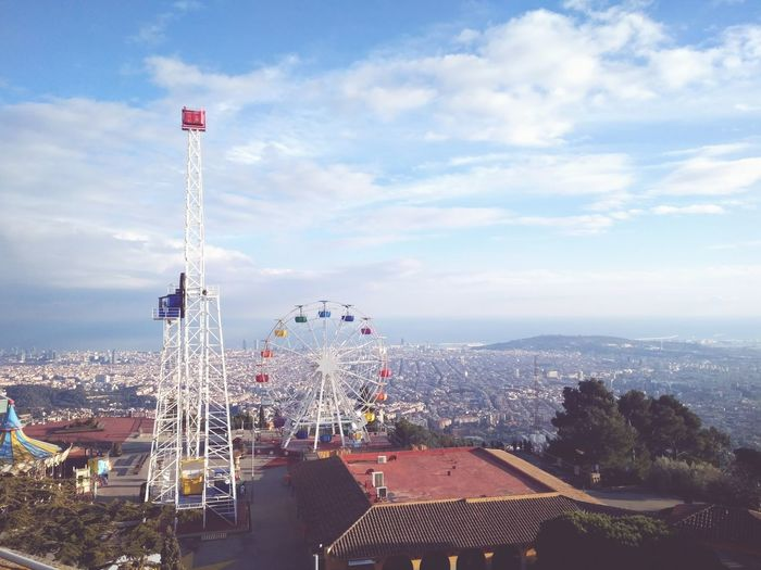 High Angle View Of Amusement Park Rides Against Sky In City