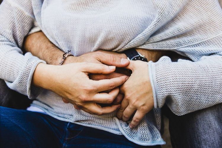 Cropped image of couple embracing