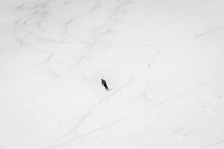 High angle view of person skiing on snowcapped field