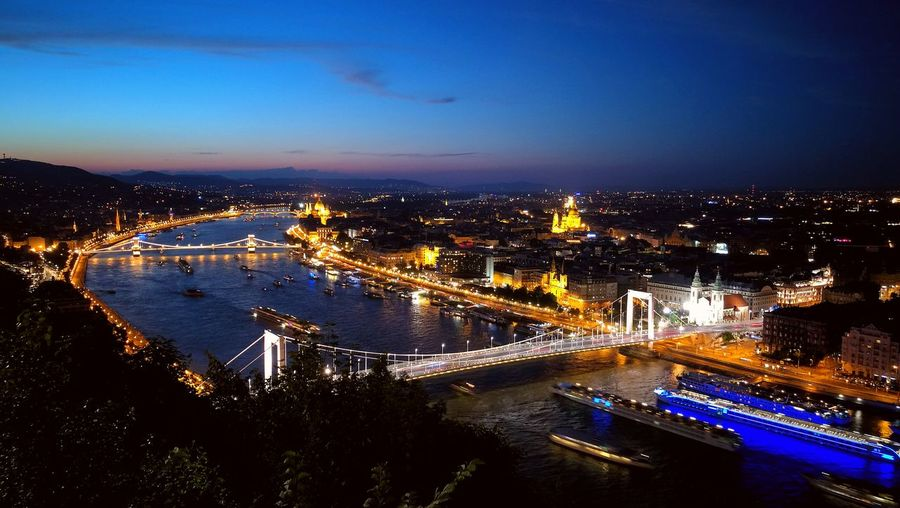 High Angle View Of River In Illuminated City At Night