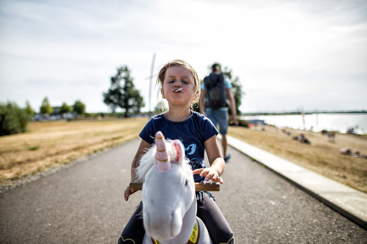 Child sitting on rocking horse