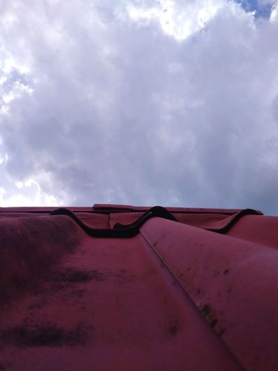 Low angle view of airplane on land against sky