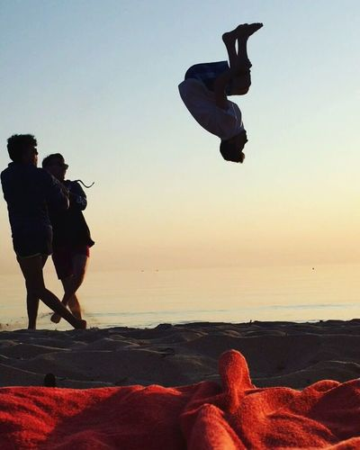 Sunrise Beach Jumping Sunset Sea Silhouette Mid-air Adult Outdoors Full Length Flying Sand Only Men Water Men Motion Sky Nature People Adults Only Day Human Body Part
