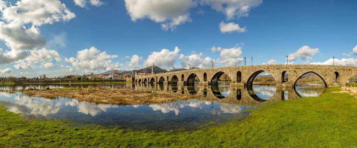 Roman bridge at Ponte de Lima, Portugal Minho Portugal Architecture Bridge - Man Made Structure Built Structure Cloud - Sky Day Grass Landscape Nature No People Outdoors Reflection River Sky Travel Destinations Tree Water