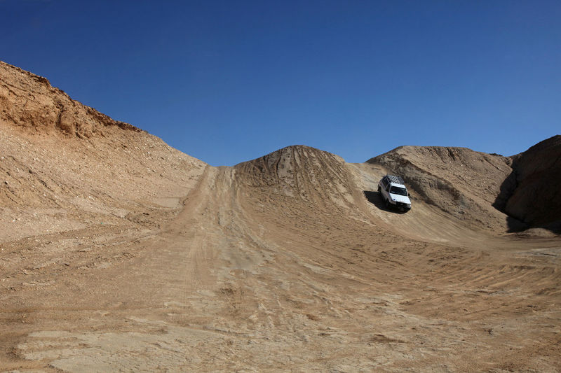 Car in desert 4x4 Car Desert Destination Dune Four Wheeldrive Land Cruiser Landscape Lonely Road Safari Sand Sand Dunes Sandscape Tourism Transportation Travel Tunisia Vacation Vehicle Way