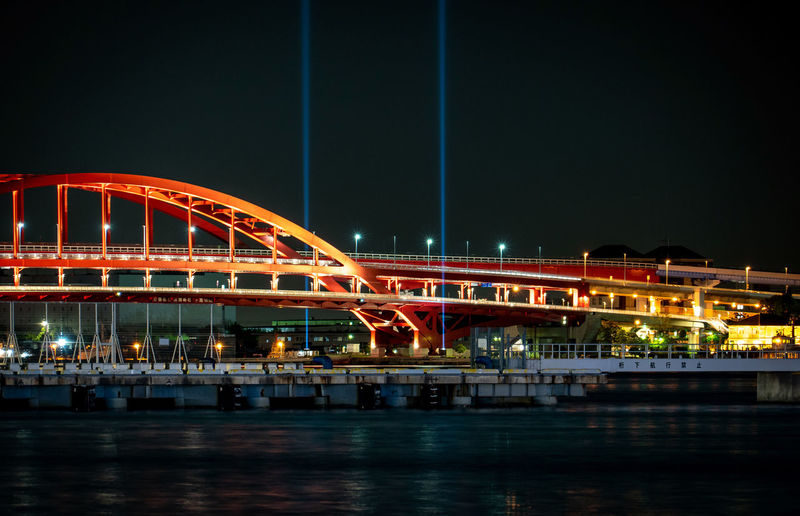 Night Illuminated Bridge Architecture Built Structure Bridge - Man Made Structure Connection Water Motion Transportation City River Building Exterior Sky Long Exposure No People Waterfront Blurred Motion Outdoors Light Trail Modern Arch Bridge