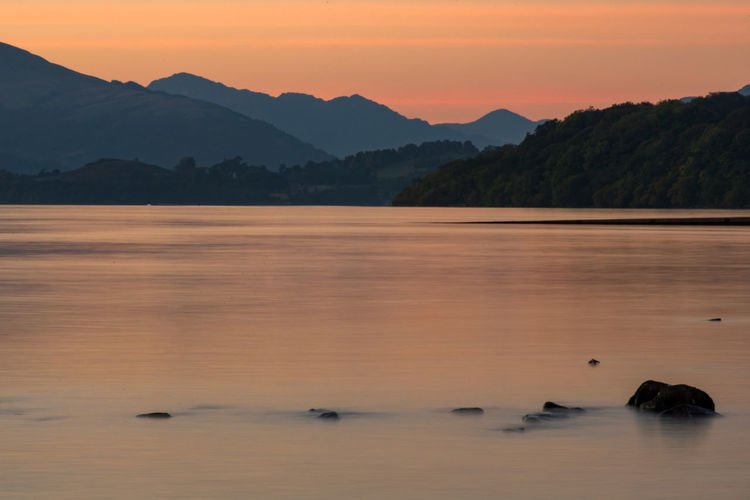 Sunset over Loch Lomond Sunset Mountain Landscape Reflection Outdoors Sun Scenics Nature Travel Destinations No People Mountain Range Tree Beauty In Nature Sky Day Water Loch Lomond Freshwater Picturesque Natural Colourful Calm Still Long Exposure Ben Lomond