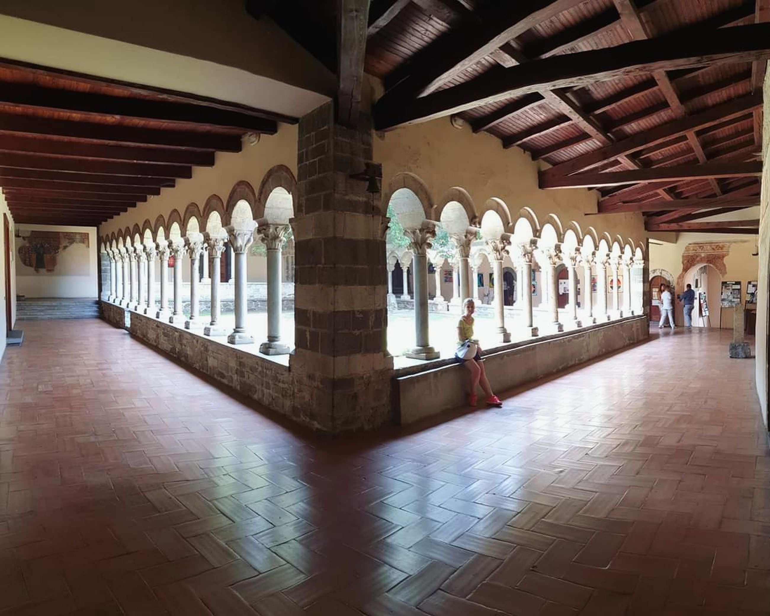 architecture, architectural column, built structure, indoors, building, incidental people, flooring, in a row, the past, arcade, colonnade, history, group of people, ceiling, day, place of worship, corridor, tile, tiled floor, women