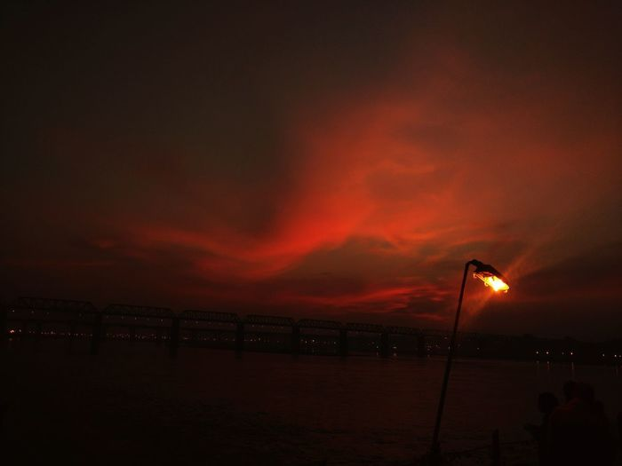 At the Ganges Night Sunset No People Beauty In Nature Outdoors Travel Destinations Water Oil Pump Illuminated Sea Scenics Sky Beach Nature The Graphic City An Eye For Travel Shades Of Winter EyeEmNewHere