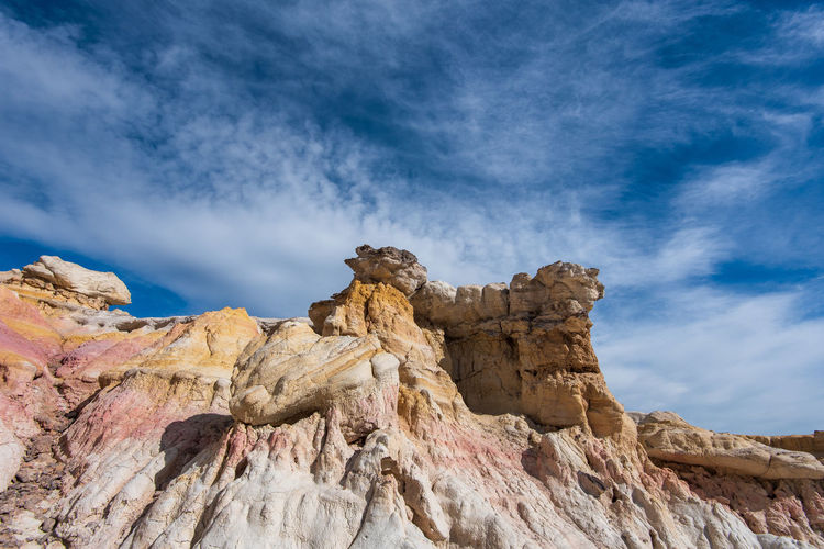Landscape of white, pink and yellow rock formations at interpretive paint mines in colorado