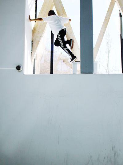 Low Angle View Of Man Balancing On Wall