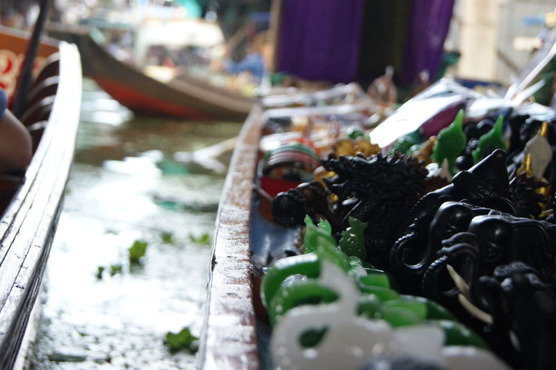 Close-up of souvenirs for sale at floating market