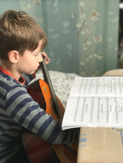 Music Education Sheet Music Musical Instrument Boys Playing Learning Musical Note Practicing One Person Indoors  Childhood Violin Musician Child Day Real People Skill  Performance Classroom