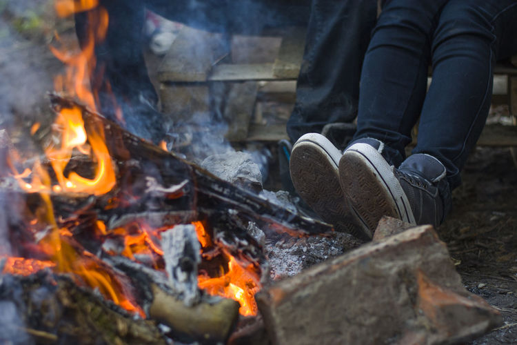 Adult Burning Close-up Coal Day Fire - Natural Phenomenon Flame Heat - Temperature Horizontal Human Body Part Low Section Nature One Man Only One Person Outdoors People Person Preparation  Real People