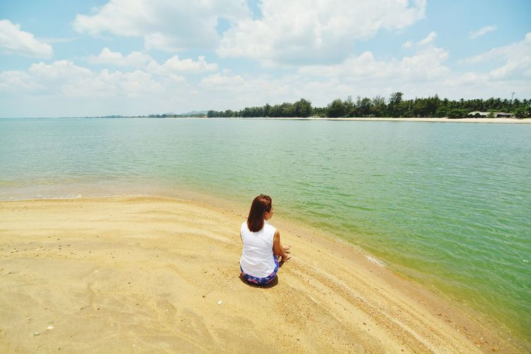 Water Beach Sky Sea Real People Beauty In Nature Rear View Scenics - Nature Women Cloud - Sky Nature Outdoors One Person Lifestyles Leisure Activity Tranquility Tranquil Scene