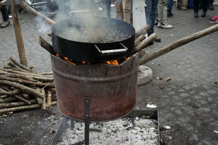street roast chestnuts Autmn Brazier Burning Chestnuts Day Elmers Flame Heat - Temperature Iron - Metal Metal Metal Industry No People Occupation Outdoors Preparation  Preparing Roast Roasted Smoke - Physical Structure Street Street Food