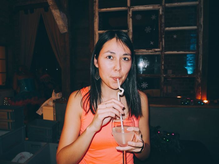 Young Woman Sipping Cocktail