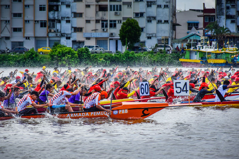 Transportation Large Group Of People Water Competition Men Outdoors Real People EyeEmNewHere Paddle Boats Boat Races Boats And Water Regatta Weekend Regatta Day Events River Riverscape People In The Background Competition.  Regatta,