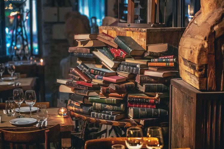 High angle view of books on table at restaurant