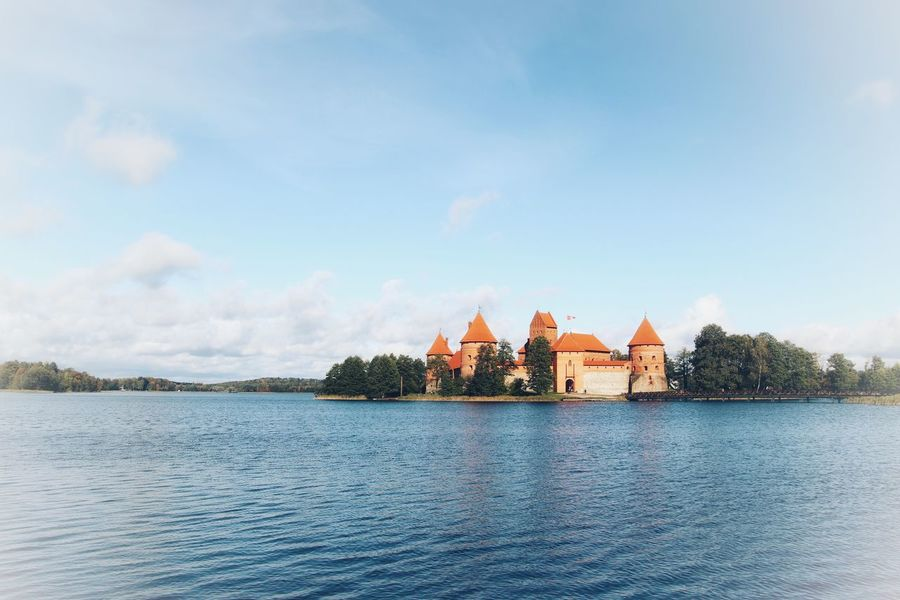 Trakai Castle lithuania Lithuania Travel Photography Trakai, Lithuania Trakai Castle Trakai Architecture Built Structure Sky Building Exterior Lake Water Day Beauty In Nature Religion Outdoors Place Of Worship Spirituality Travel Destinations Waterfront Tranquility Cloud - Sky Scenics No People Nature Tree