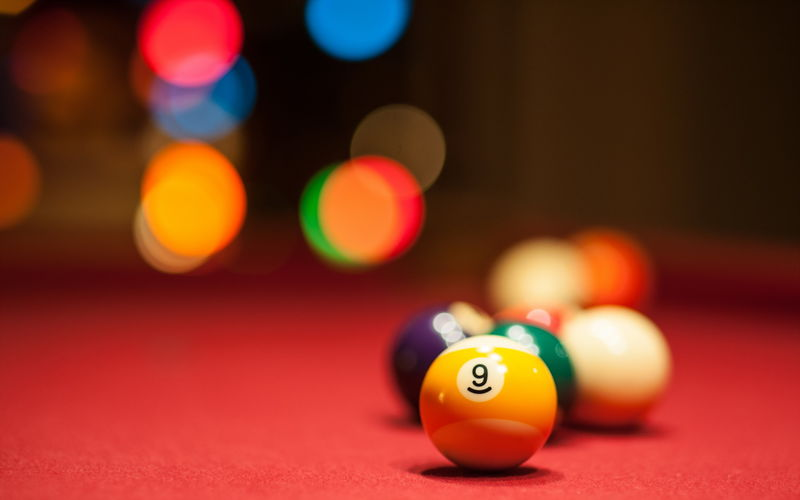Close-Up Of Number 9 Pool Balls On Table