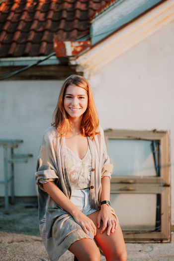 Architecture Beautiful Woman Building Exterior Built Structure Casual Clothing Day Focus On Foreground Happiness House Leisure Activity Lifestyles Looking At Camera One Person Outdoors Portrait Real People Smiling Young Adult Young Women