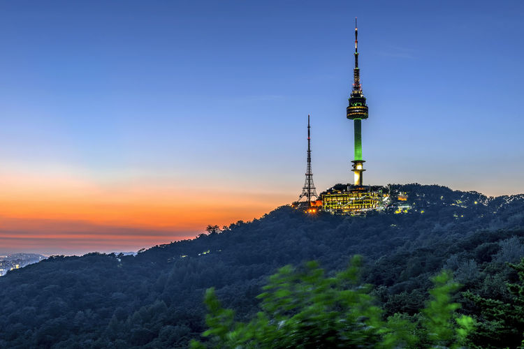 Twilight Seoul Tower in Spring at south korea. Architecture Beauty In Nature Building Building Exterior Built Structure Communication Mountain Nature No People Outdoors Plant Sky Spire  Sunset Tall - High Technology Tourism Tower Travel Travel Destinations Tree