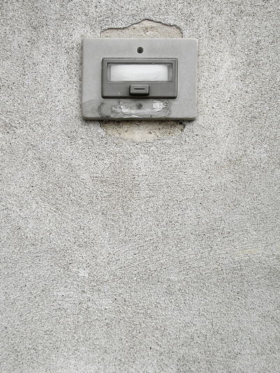 Close-up detail shot of old weathered Italian door bell on concrete wall Architecture ArchiTexture Built Structure Close-up Concrete Copy Space Day Door Bell Full Frame Grey Italian No People Old Textured  Textures And Surfaces Wall Weathered