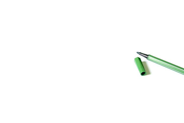 green pen on white background with copy space. Close-up Copy Space Day Green Color Green Pen Indoors  No People Single Object Stationary Still Life Studio Shot White Background Writing Writing Instrument