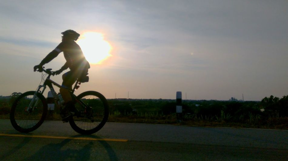Only Men Sunset Adventure Silhouette Transportation Sunlight Bicycle Real People Outdoors Si Racha Sporty Sports Day  Sport