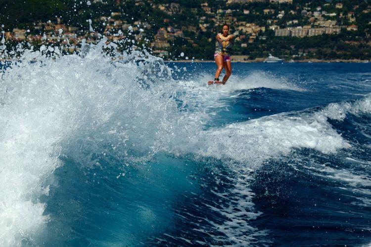 Woman wakeboarding in sea