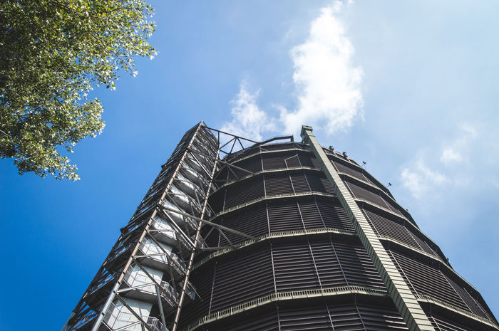 Low angle shot of industrial building against blue sky Architecture Architecture Blue Blue Sky Built Structure Clouds Day First Eyeem Photo Gasometer Oberhausen Industrial Industrial Photography Industry Looking Up Modern Outdoors Sky Sky And Clouds Tall Tall - High Tree