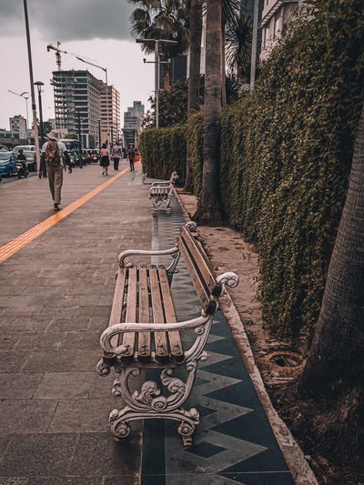 Benches on sidewalk in city
