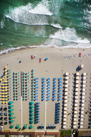 Top view of the equipped beach of Forte dei Marmi at the beginning of the summer season Forte Dei Marmi Aerial View Beach Italy Sea Versilia  Vacation Landscape Tourism Sand Resort Summer White Leisure Coast Destination Nature Travel Relaxation Scenic Mediterranean  Tuscany Water Land Day Outdoors Holiday