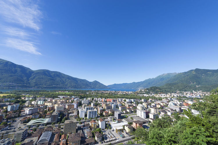 Panoramic view over city Locarno with mountain in a sunny day in Ticino, Switzerland. Architecture Blue Sky Building Exterior Built Structure City City Life Cityscape Colorful Day Elevated View Famous Place House Landscape Mountain Mountain Range Nature No People Outdoors Panoramic View Residential Building Summer Swiss Alps Town Travel Destinations Urban Skyline