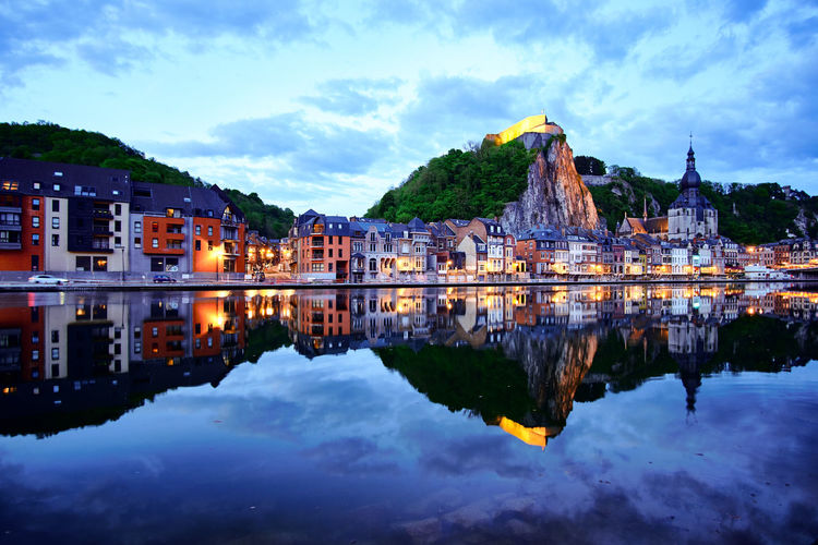 Dinant by dusk - Architecture Belgium Building Exterior Built Structure Cloud - Sky Day Dusk Mountain Nature No People Outdoors Place Of Worship Reflection Sky Tourism Travel Travel Destinations Water Waterfront