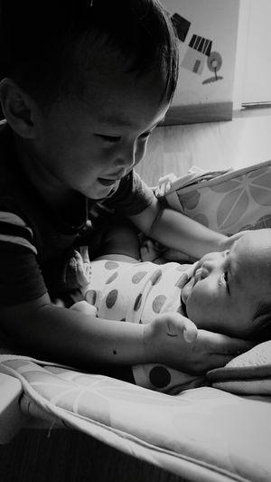 Close-Up Of Cute Siblings At Home