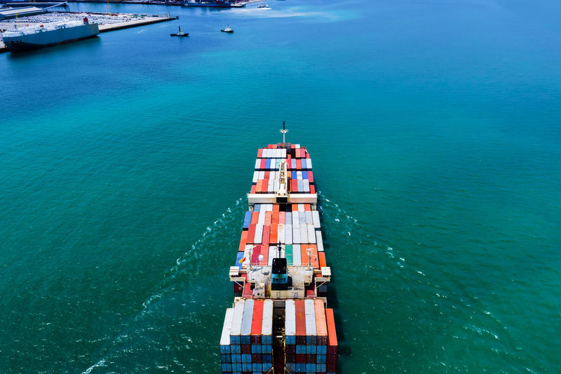 High angle view shipping containers cargo logistics transportation over the sea