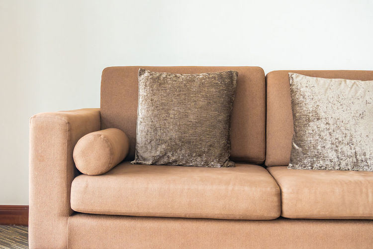 Close-up of sofa against white background