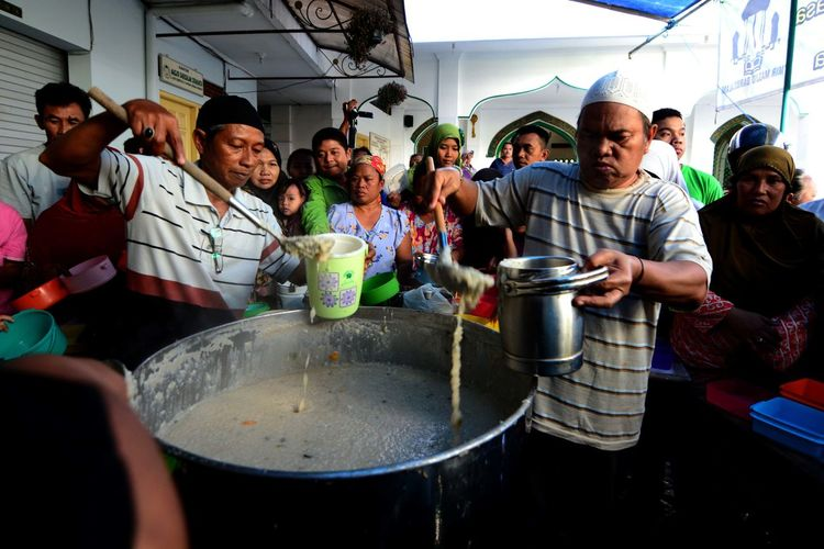Ramadan in Indonesia. Real People Group Of People Women Men Food And Drink Lifestyles People Food Adult Leisure Activity Crowd Standing Group Day Males  Household Equipment Boys Casual Clothing Child Preparation  Teenager Preparing Food Teenage Boys Adolescence