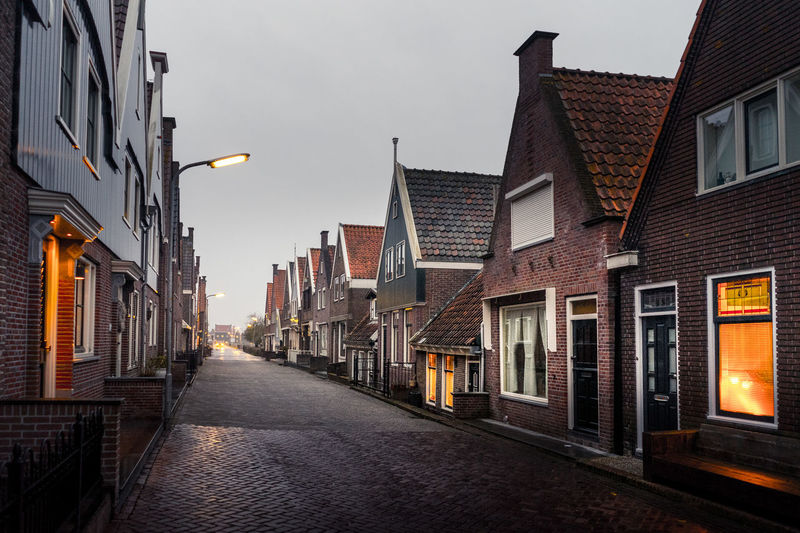 Alley Architecture Building Building Exterior Built Structure City Direction Dusk Footpath House Lighting Equipment Narrow Nature No People Outdoors Residential District Row House Sky Street Street Light The Way Forward Window