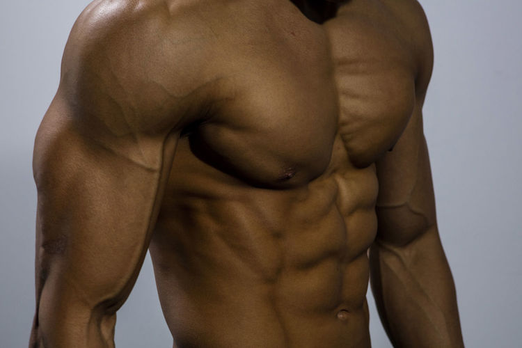 Midsection Of Shirtless Muscular Man