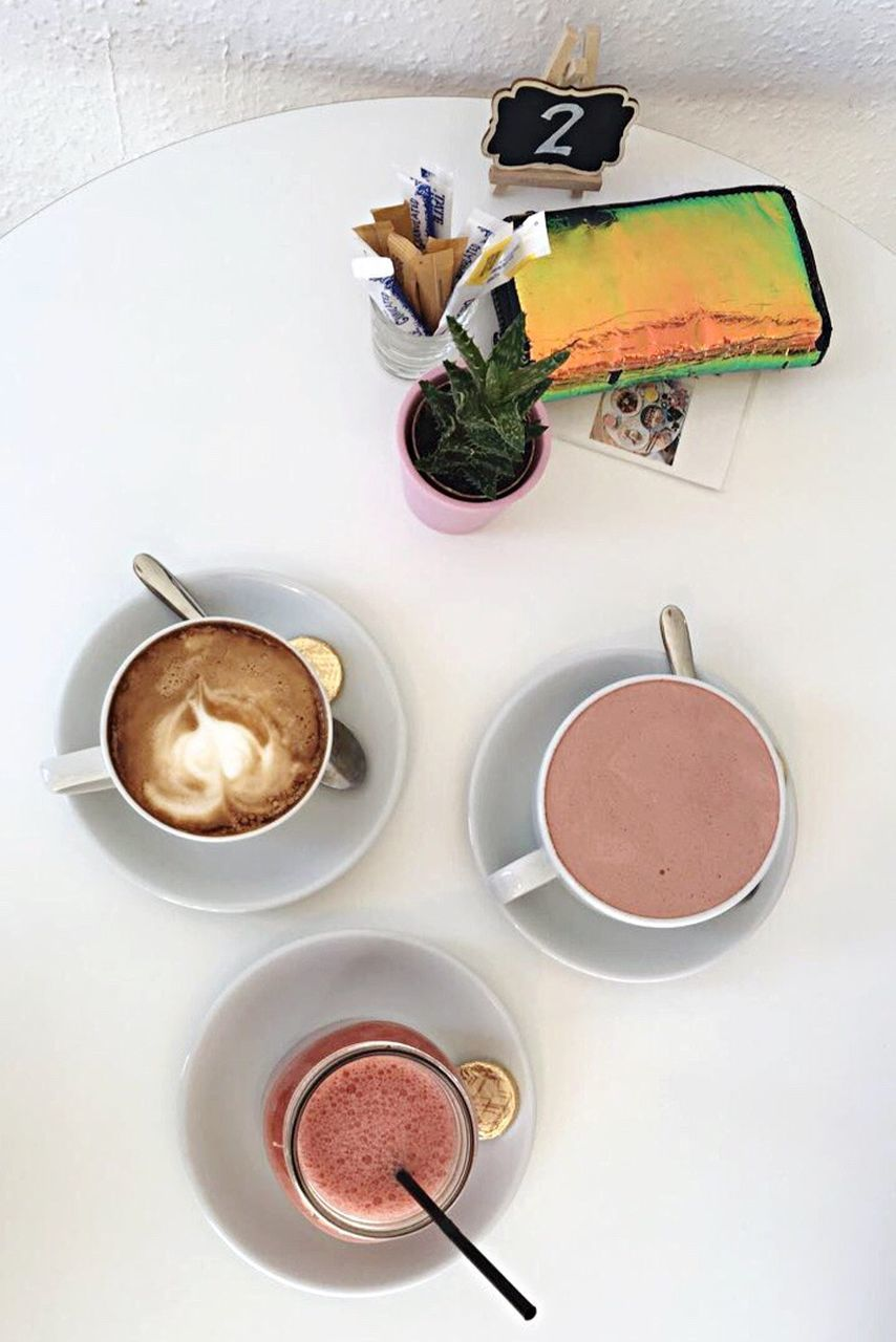 coffee cup, food and drink, coffee - drink, high angle view, table, drink, no people, indoors, freshness, food, healthy eating, flower, day, ready-to-eat, close-up