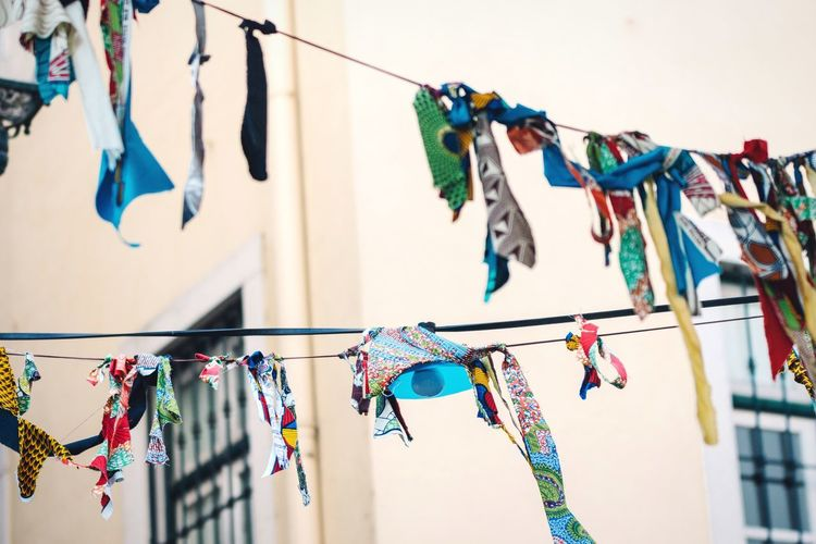 Colors in the sky Hanging Multi Colored Variation Clothesline Clothing No People Laundry Clothespin Lingerie Outdoors Day Clip Sky Colorful Multicolors  Handmade For You Art Close-up Lisbon Lisboa Cloth Clothing Line Wire Selective Focus Randomness